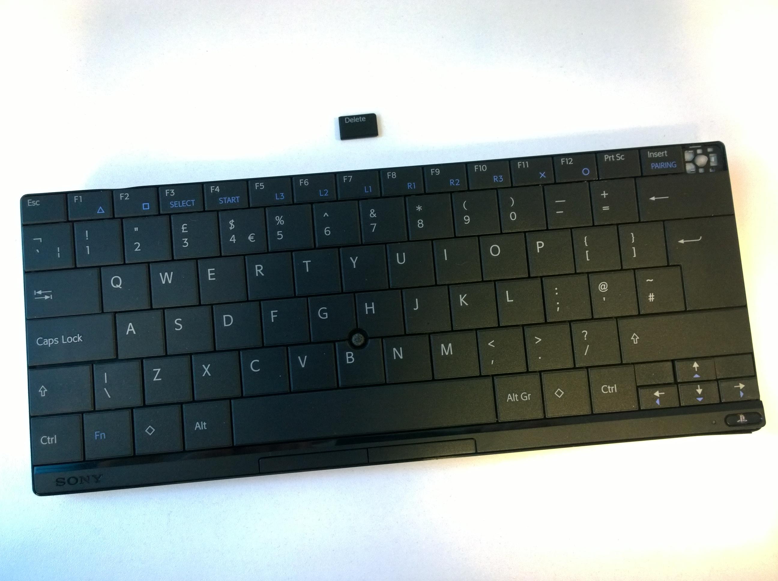 [PS3] Klávesnice Sony Wireless Keyboard (bez jedné klávesy)