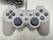 [PS1] Drátový Ovladač Sony Dualshock - bílý (různé estetické vady)